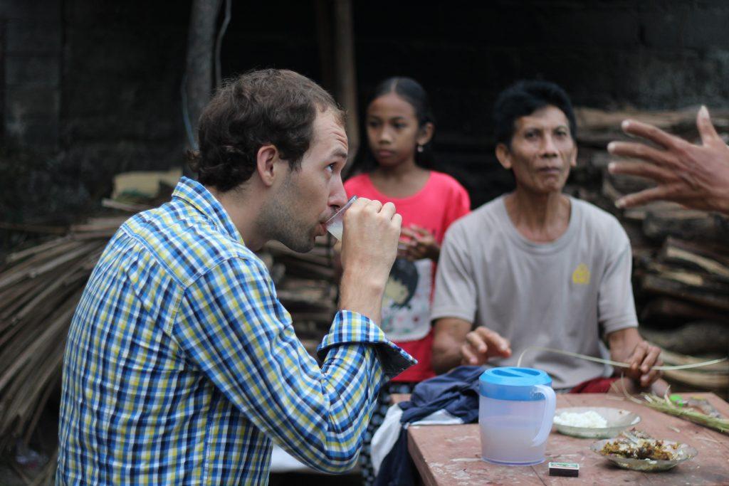 Drinking rice wine with locals in Teganan village