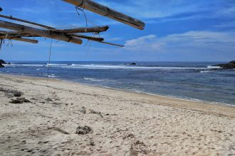 surfing beach east from Kuta